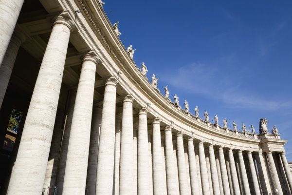 ITALY, Lazio, Rome, Vatican City The sweeping colonnade by Bernini topped with statues that circles Piazza San Pietro or St Peter's Square