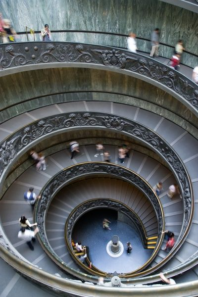 ITALY, Lazio, Rome, Vatican City Museum Tourists walking down the Spiral Ramp designed in 1932 by Giuseppe Momo